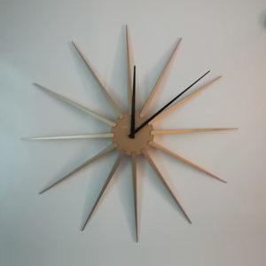 Orologio da parete Nova oro a forma di stella