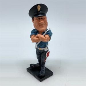 Statuina, caricatura mestiere, professione Poliziotto con base